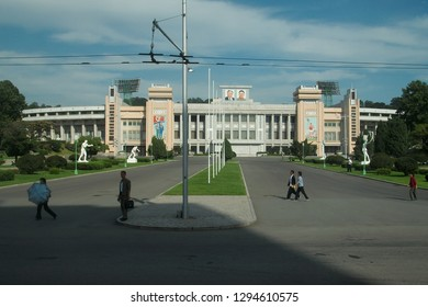 Pyongyang, North Korea - AUG 2012: The local citizens walking the road near a building in Pyongyang City