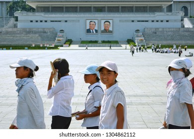 Pyongyang, North Korea - AUG 2012: The female students walking on the Kim Il-sung Square in Pyongyang city