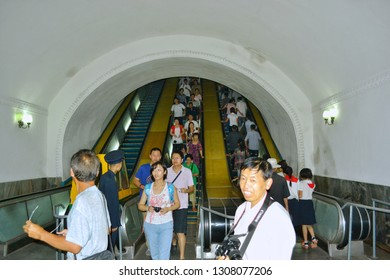Pyongyang, North Korea - AUG 2012: People are standing on the elevator and waiting for the platform to take the Pyongyang subway.