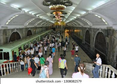 Pyongyang, North Korea - AUG 2012: People take the urban rail transit at the Pyongyang Metro Puhung Station.