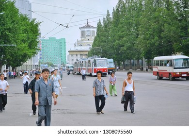 Pyongyang, North Korea - AUG 2012: The local people are walking on the street in urban of Pyongyang City