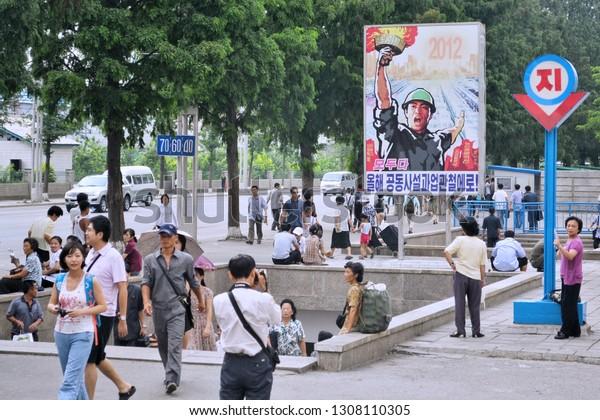 Pyongyang, North Korea - AUG 2012: The tourists shot the landscape of entrance of Pyongyang Subway