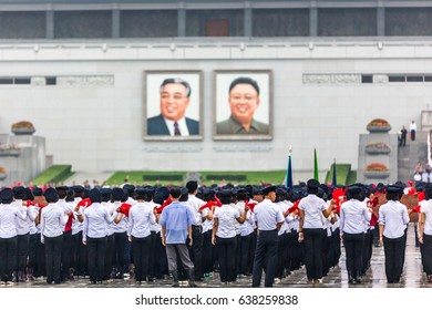 Pyongyang, North Korea - August 15th 2016 - Big group of students practicing an exercise in front of North Korea's  leader pictures.