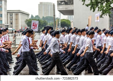 Pyongyang, North Korea - August 15th 2016 - Big group of students marching in Pyongyang, North Korea capital in a cloudy day.