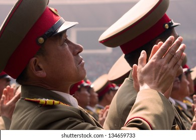 PYONGYANG, NORTH KOREA - CIRCA APRIL 2012: North Korea army officer cheers for Kim Jong-Un at the military parade celebrate centenary birth of President Kim Il Sung in Pyongyang circa April 2012.