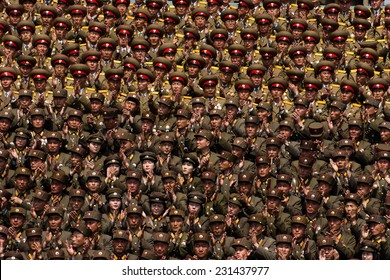 PYONGYANG, NORTH KOREA - CIRCA APRIL 2012: North Korea army officers cheers for Kim Jong-Un at the military parade celebrate centenary birth of President Kim Il Sung.