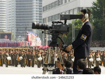 PYONGYANG, NORTH KOREA - CIRCA JULY 2013: North Korea cameramen at the military parade celebrating the 60th anniversary of the conclusion of the Korean War. Pyongyang, North Korea. Circa July 2013