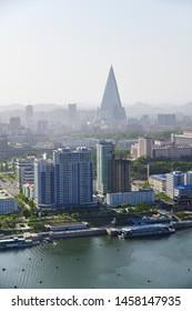 Pyongyang, North Korea - May 1, 2019: City skyline of Pyongyang and Taedong river at sunset