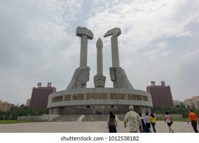 Pyongyang, North Korea-August 15,2016:Monument to the Korean Workers Party,consists of a Hammer (Industry) a Calligraphic brush (Art and literacy) and a Sickle (agriculture).
