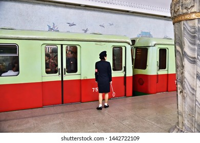 Pyongyang, North-Korea - May 1, 2019: Girl in uniform at the Yonggwang subway station. Pyongyang Metro