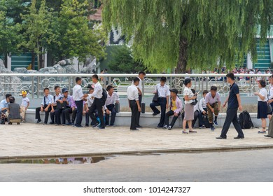 Pyongyang,North Korea - August 13,2016:North Korean students standing near the road waiting for another group come to join them.