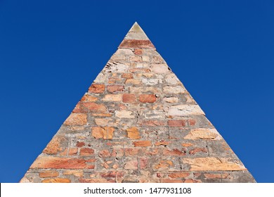 A pyramid built from stone. Pyramid scheme concept image.