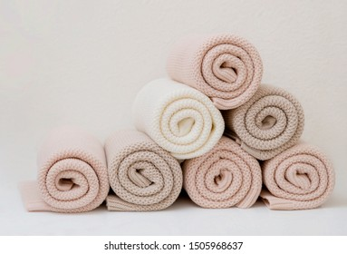 A pyramid of colorful cotton plaids rests on the table. They are twisted in a spiral.
