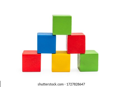 Pyramid from colorful wooden toy bricks on white.