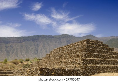 A pyramid construction at the base of the mountains