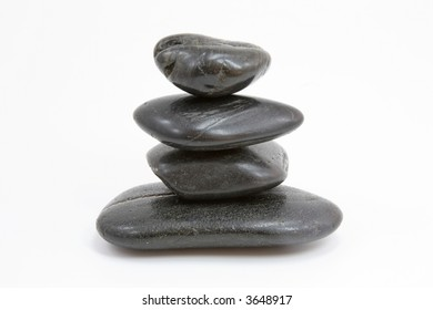 Pyramid of four stones on a white background