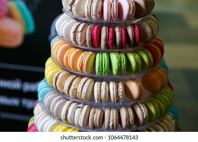 Pyramid of French macaroons. Close-up. Candy bar.