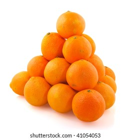 Pyramid from healthy tangerines isolated over white