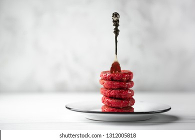 Pyramid of heesecakes with honey - russian traditional breakfast. Food consept. Plate with cakes on white marble background, Copyspace for text and design elements.