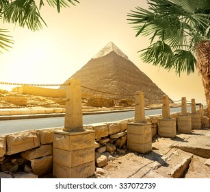 Pyramid of Khafre and asphalted road with columns