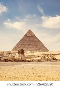 Pyramid of Khafre (Chephren) and Great Sphinx of Giza, famous egyptian landmarks in Cairo. Sphinx is a mythical creature with lion body in ancient culture of Egypt and oldest monumental sculpture.