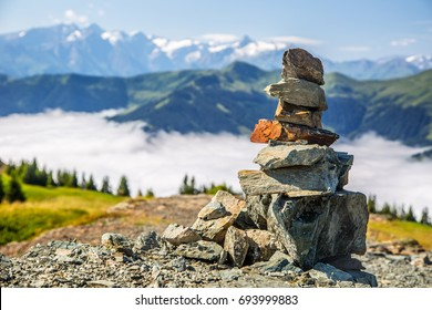 Pyramid made by stones and austrian alps in the background. Photo taken on Asitz moutain in Leogang Salzburg.