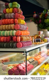 Pyramid made of colorful, French macaroons presented in street display, in Parisian patisserie.
