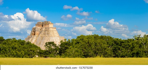 Pyramid of the Magician in the jungle,  a Mesoamerican step pyramid, Uxmal, an ancient Maya city of the classical period. UNESCO World Heritage site
