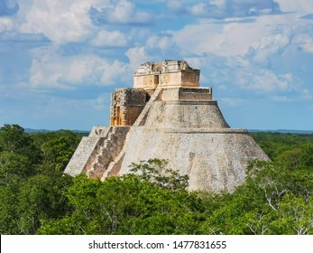 Pyramid of the Magician. -Mayan ruins of Uxmal, Yucatan, Mexico, side view - Archeological site, tourist destination, The pyramid is the biggest in the ruins of the ancient Mayan city Uxmal.