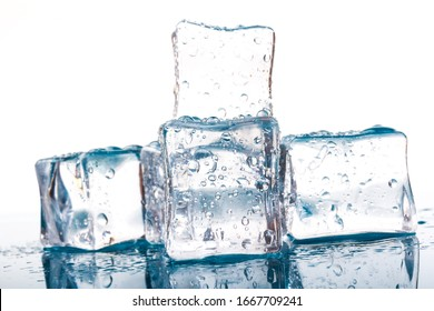Pyramid of the melted ice cubes with drops.ice cubes and water drops close up on blue and white background
