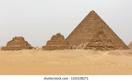Pyramid of Menkaure along with three small pyramids at Giza