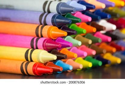 pyramid of multicolored new crayons bright closeup