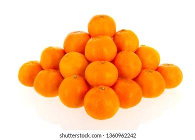 pyramid from orange mandarins isolated over white background