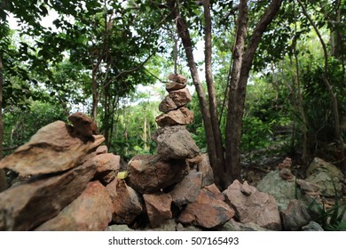 The pyramid of pebble stones on the nature background,shallow depth of field,light and shadow