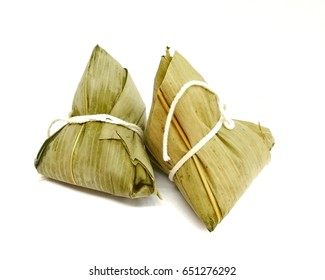 pyramid shaped dumplings made by wrapping glutinous rice in bamboo leaves isolated on white background.