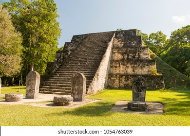 Pyramid and stele in the Complex Q area of the Mayan ruins at Tikal, Guatemala