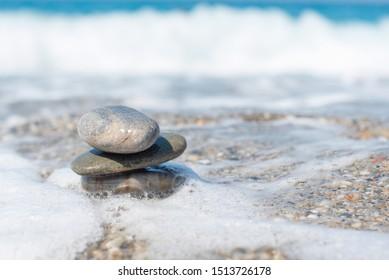 pyramid of stones by the sea. balanced stones.