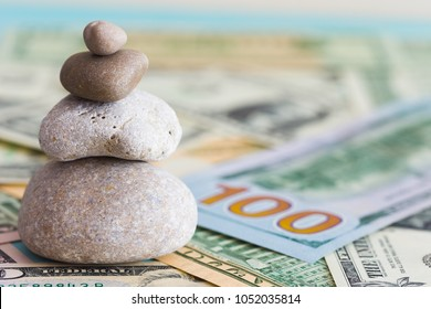 Pyramid of stones and dollar banknotes