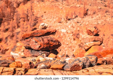 Pyramid of stones on mountainside on sunny day