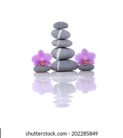 Pyramid of striped stones and beauty orchid