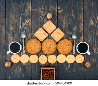 Pyramid of various types and forms of biscuit. Two cups of coffee and two metal spoon.Temny vintage wooden background. - Shutterstock ID 504454909
