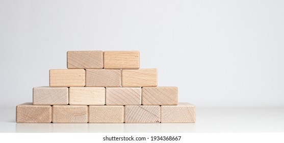pyramid of wood blocks on the white background with copy space