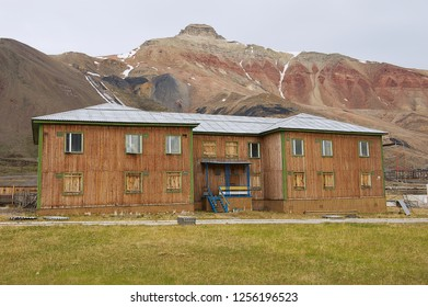 Pyramiden, Norway - September 03, 2011: Deserted old wooden residential building at the abandoned Russian arctic settlement Pyramiden, Norway.