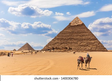 The Pyramids and bedouins in the desert of Giza, Egypt