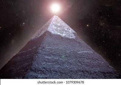 Pyramids of Giza in the background of the starry night sky.