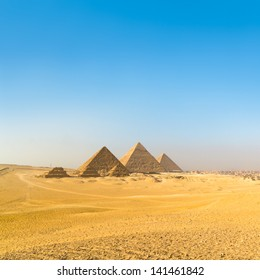 The pyramids of Giza, Cairo, Egypt;  the oldest of the Seven Wonders of the Ancient World, and the only one to remain largely intact