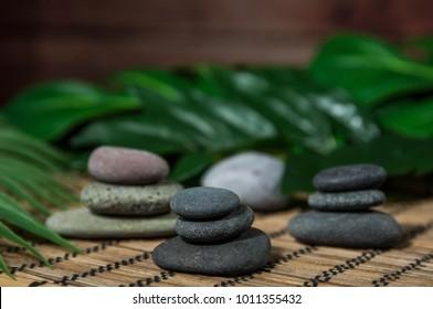 Pyramids of gray zen stones. Concept of harmony, balance and meditation, spa, massage, relax