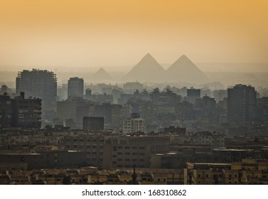 Pyramids in the mist, Cairo, Egypt. Largest city in Africa.