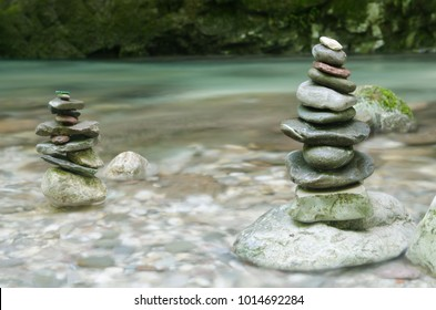 Pyramids of pebble stones and fresh water stream in Soca valley, Slovenia