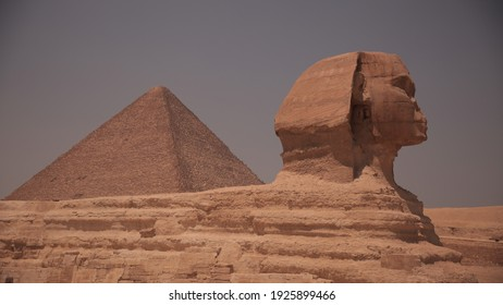 The pyramids and the Sphinx at noon in the desert of Egypt